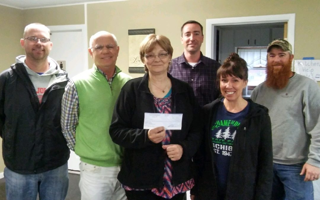 Pat O'Brien & Associates donates to The Depot