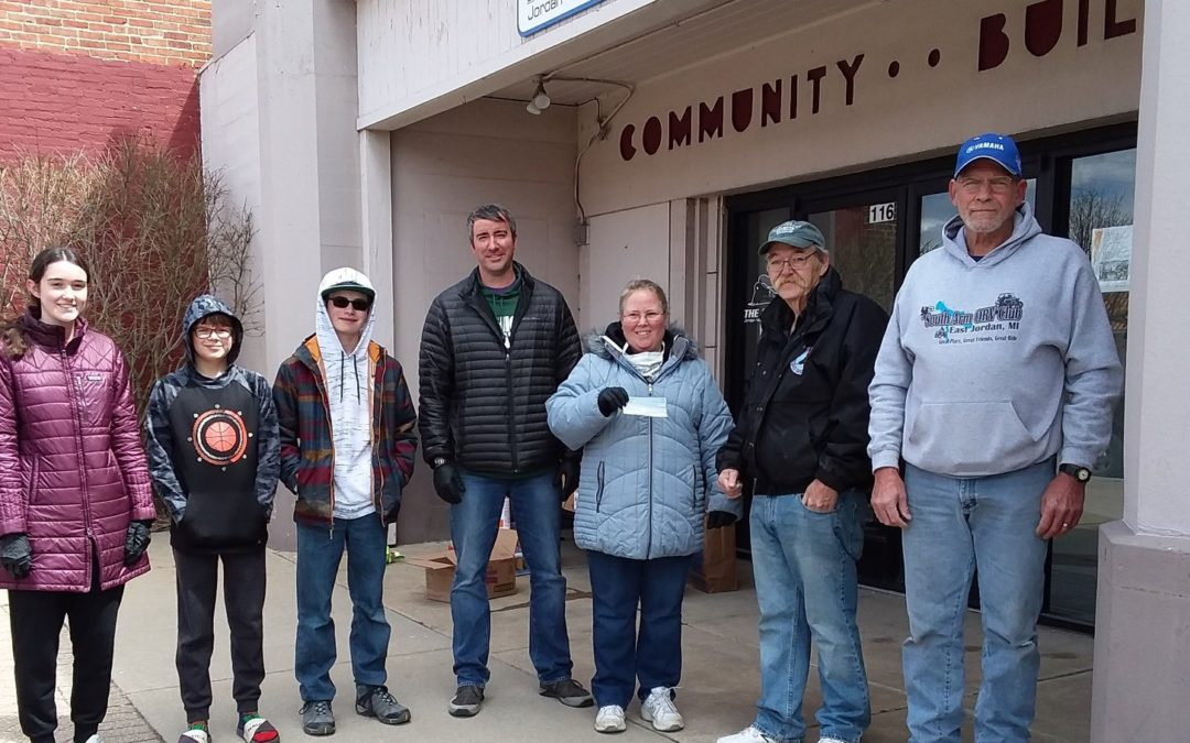 South Arm ORV Club makes donation for Free Food Bags.